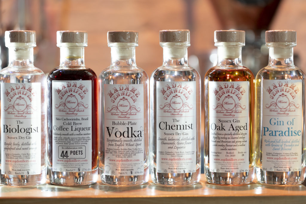 A lineup of six spirit bottles from Madame Jenifer's distillery in Hove