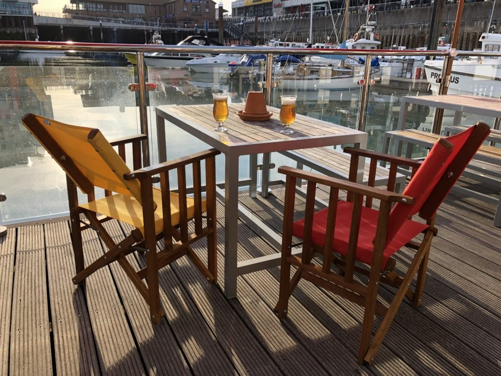 Canvas chairs with marina view