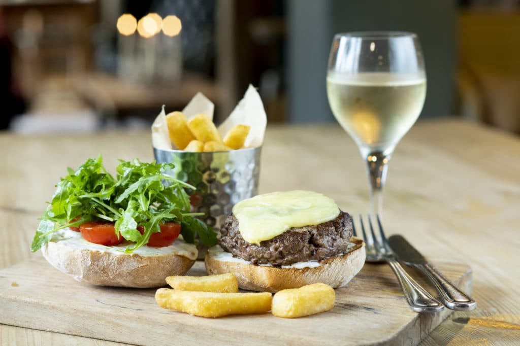 burger and chips with a glass of wine
