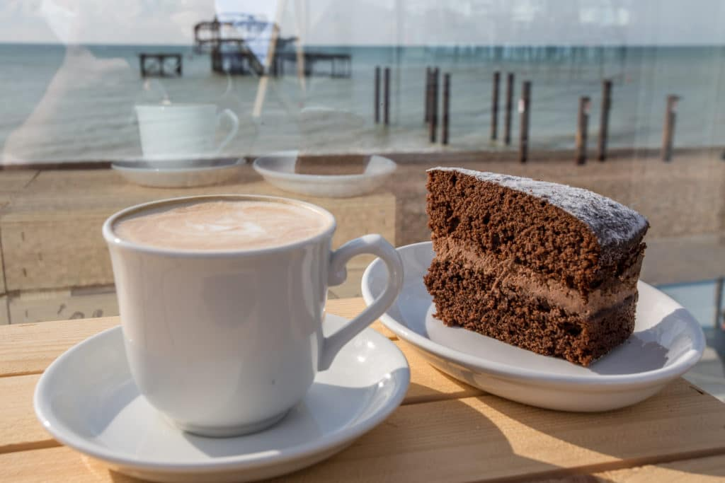 Coffee and cake on a seafront terrace