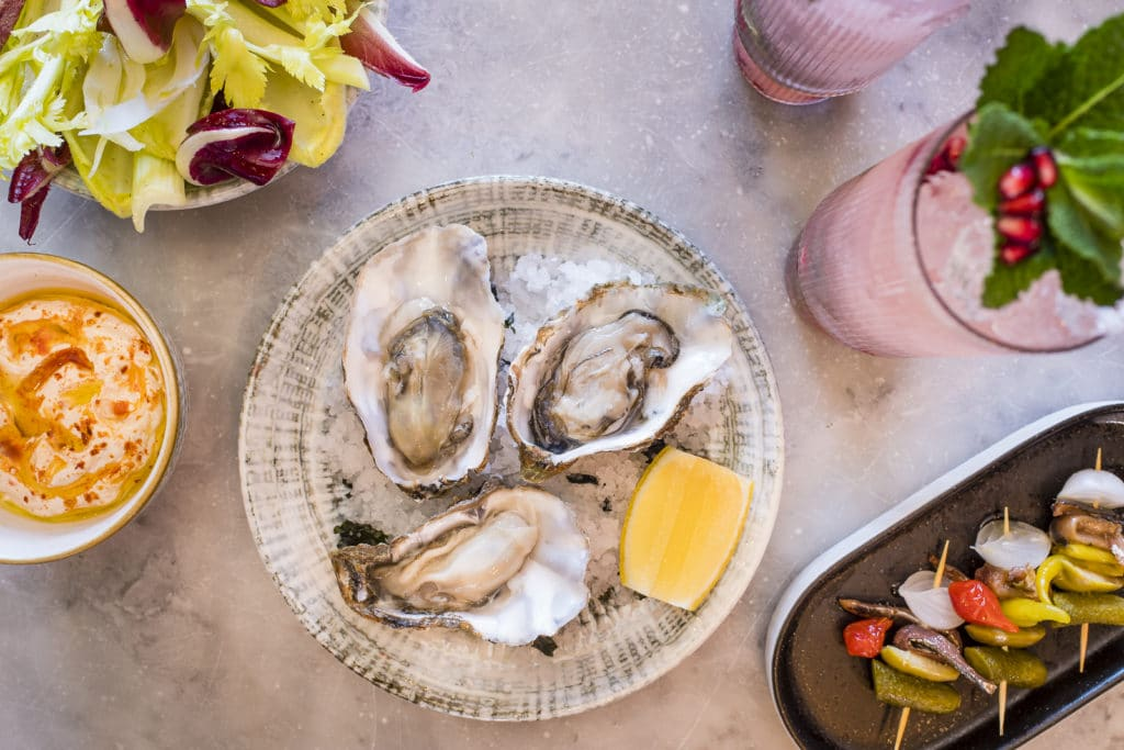Burnt Orange oysters and cocktails