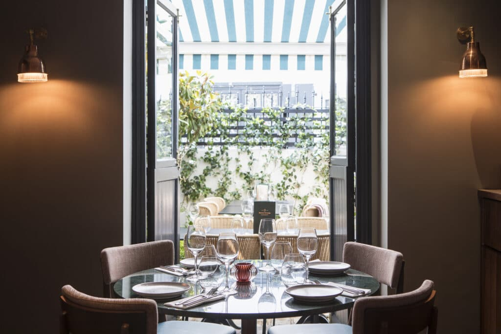 A view through the restaurant, Burnt Orange Brighton, onto its terrace