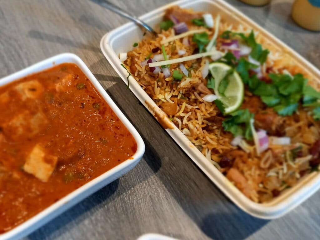 biryani close up in a takeaway container