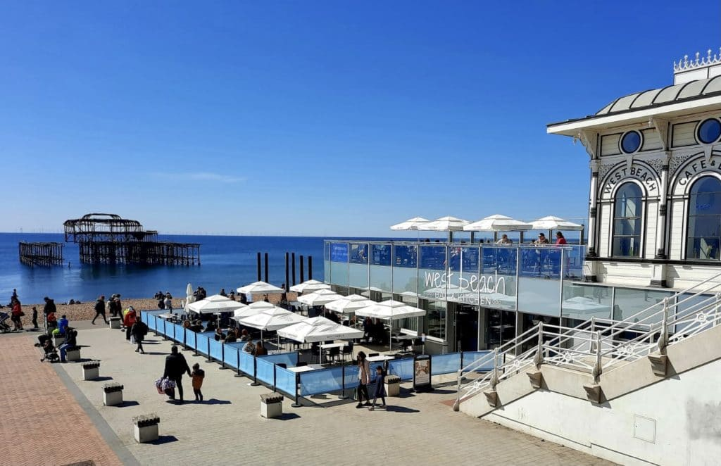 View over West Beach Bar and Kitchen terrace with the West Pier in the distance on a clear day
