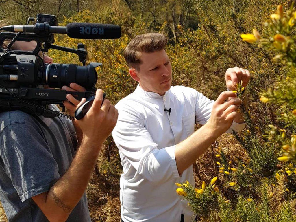 Chef Jean Delport being filmed picking gauze flowers