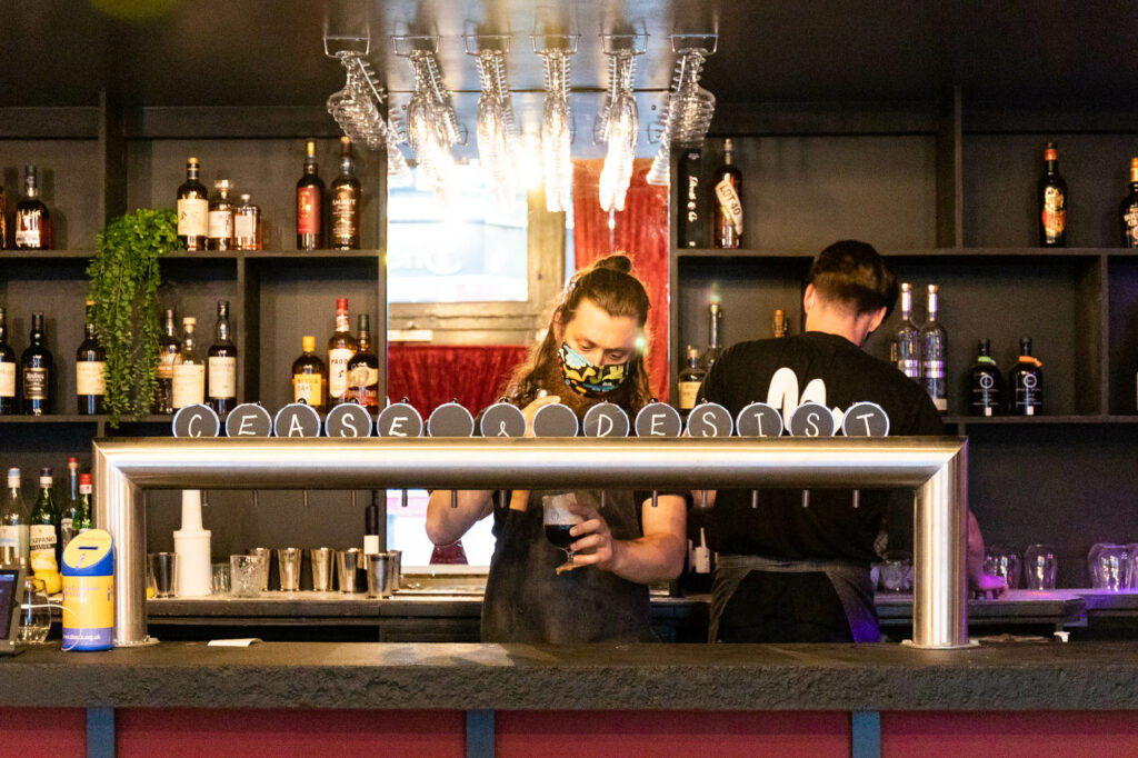 The beer taps and bar men at Slow + Low Smokehouse