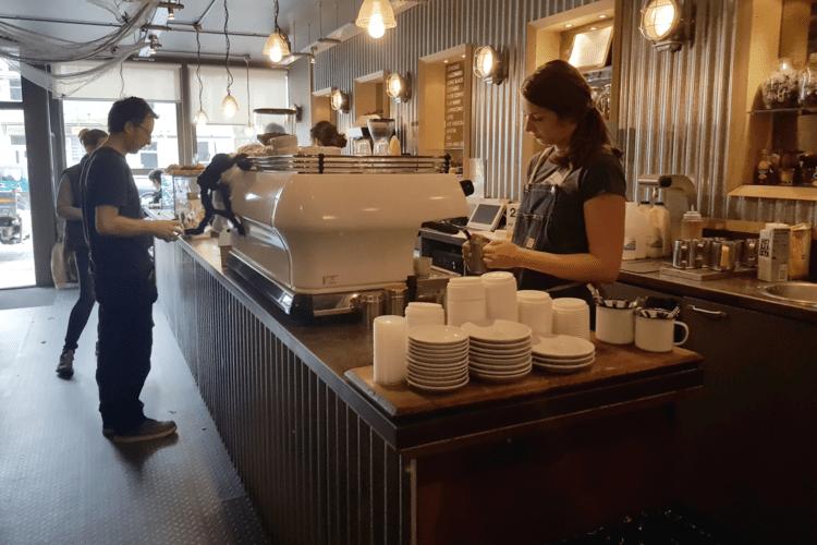 Inside Goldstone Small Batch coffee shop, a woman is making coffee