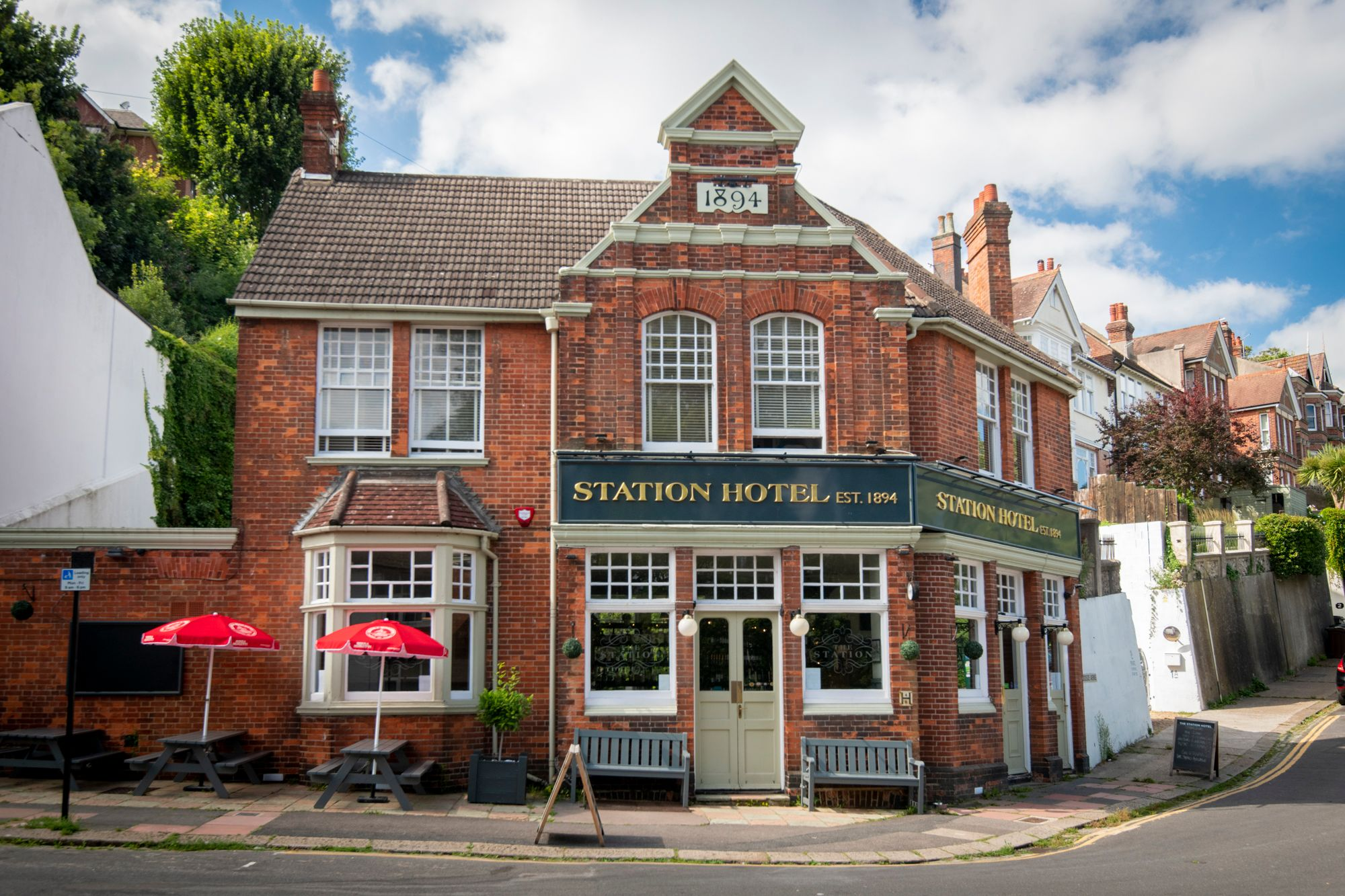 pub with traditional red brick and classic hung sash windows