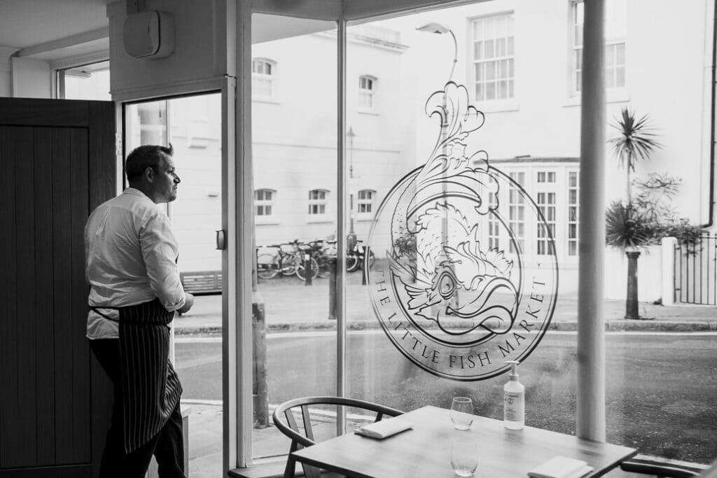 Chef Duncan Ray in the door of his restaurant, The Little Fish Market