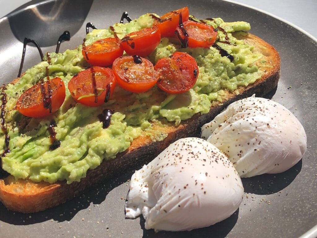 Avocado on toast with two poached eggs