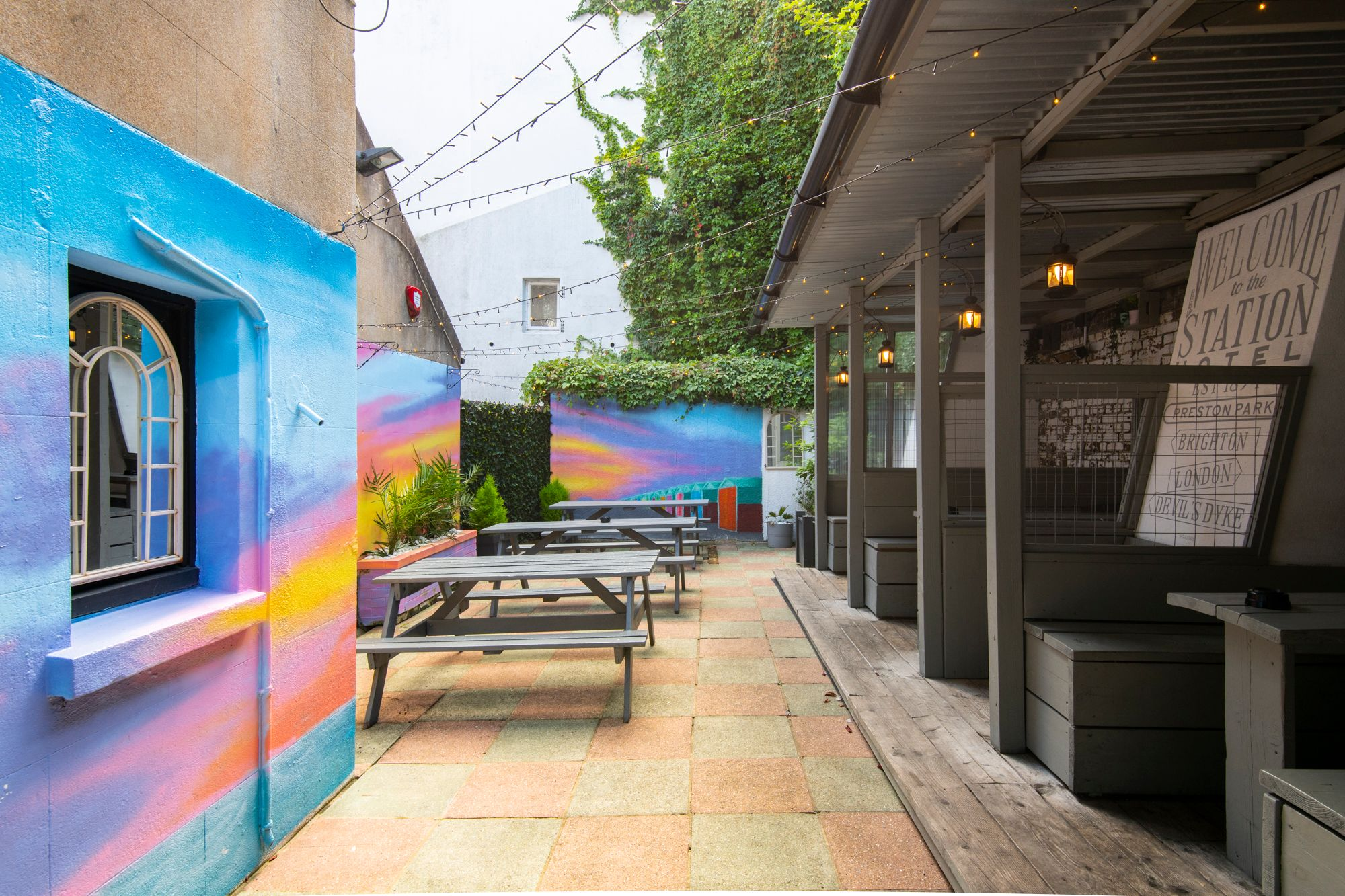 courtyard with colorful painted walls and private area with wooden benches