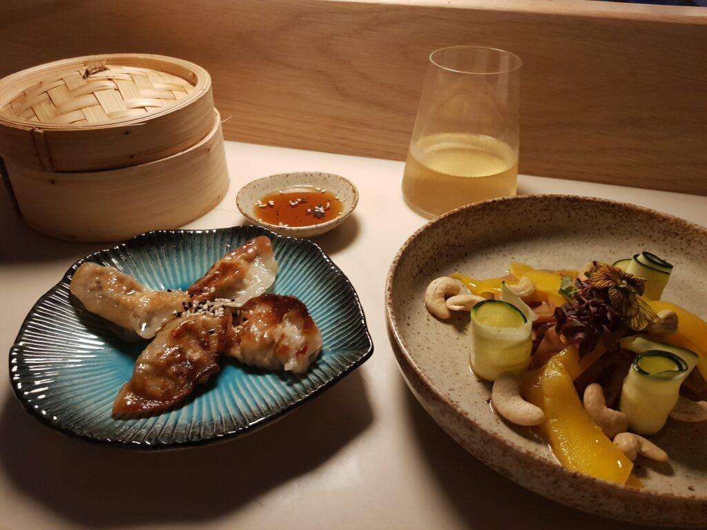 mango and courgette salad, gyoza, bamboo steamer and white wine