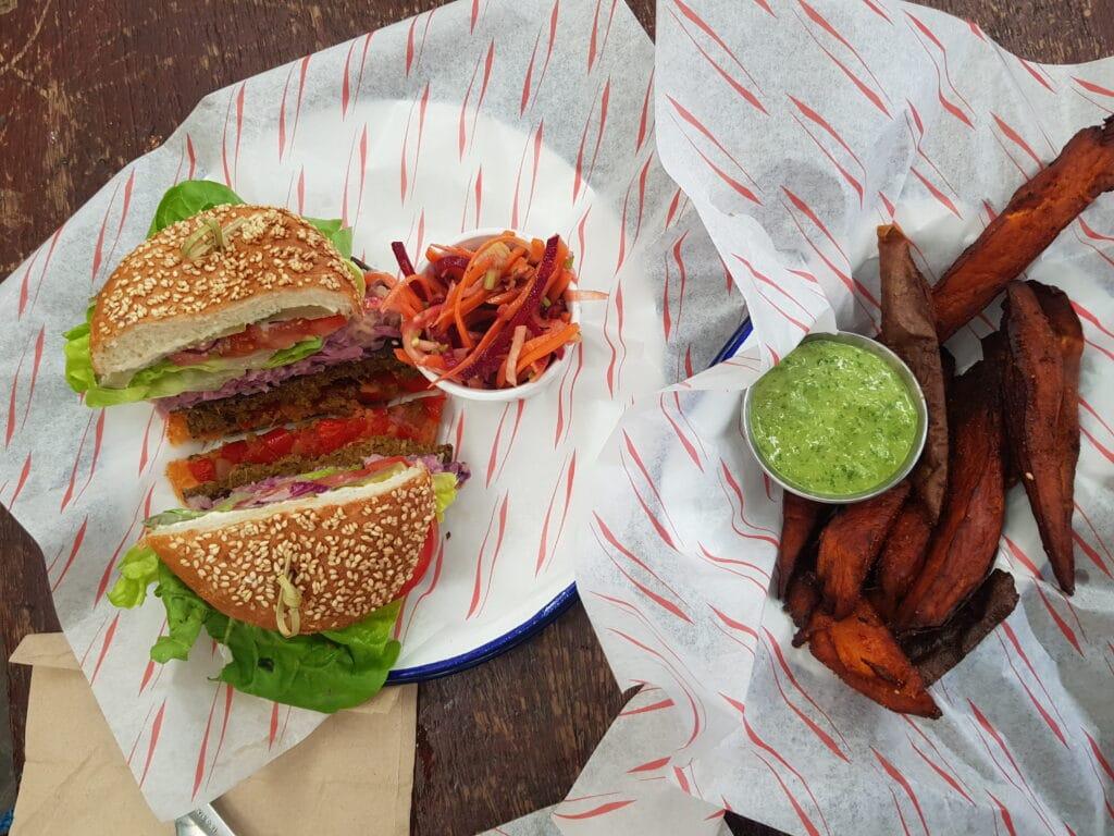 Vegan burger and sweet potato fries take over head