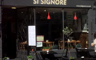 Exterior photograph taken of Si Signore and the alfresco seating
