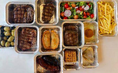 Takeaway tasting menu with meats, salad, fries and desserts.
