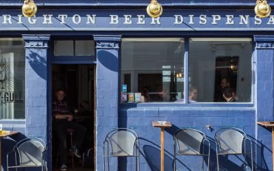 Blue painted Brighton Beer Dispensary exterior on a sunny day