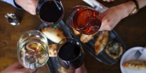 Cheers of wine glasses at Cafe Malbec - Private Parties