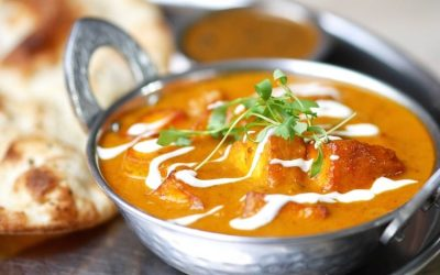 Kadai Paneer Curry in Curry Leaf Cafe Brighton, served in a metal dish with breads and dip.