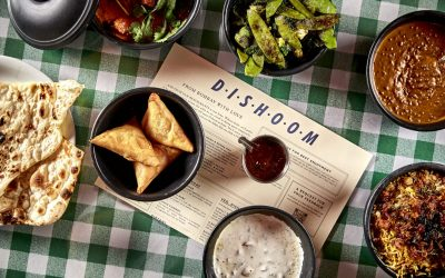 Dishoom dishes on a green checked table cloth