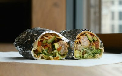 Italian street food wrap made with angel hair pasta, spicy sausage and pomodoro sauce