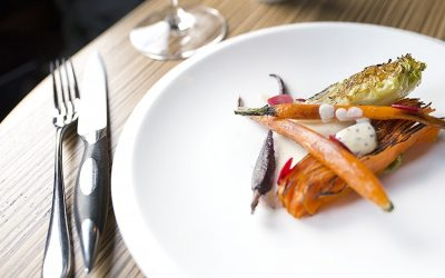 A minimalist plate of carrots, beetroot and charred gem lettuce served on a porcelain plate