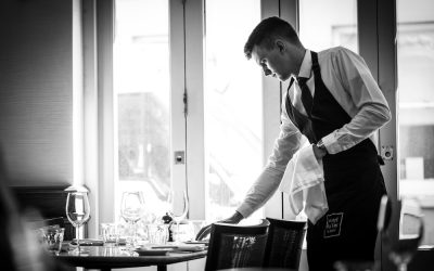 Interiors shot at Hotel Du Vin with a waiter preparing the tables.