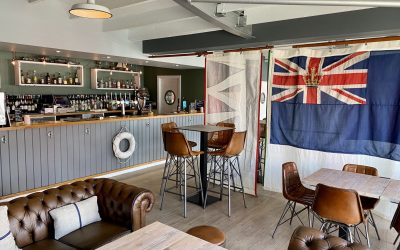 Nautically themed interior at The Watershed with view of the bar