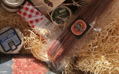 Cheese and charcuterie laid out in the hamper from The Great British Charcuterie subscription box
