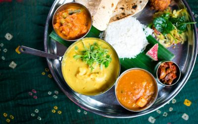 Indian thali platter with a selection curries, rice and chapati.