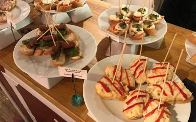A selection of different pinchos served on white plates