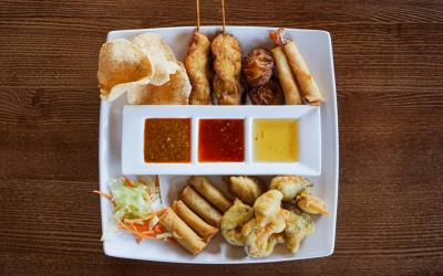 Thai mixed starters, prawn crackers, chicken satay, spring rolls and tempura vegetables
