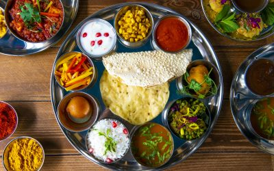 Thali platter with curries, dips, poppadoms and rice