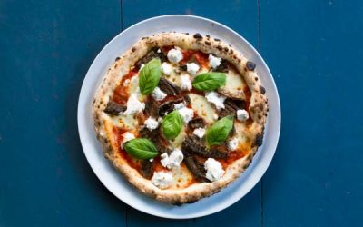 RB MARCH Sat 27th 3.55pm - Pizza picture from above against a blue table, topped with ricotta, fresh basil and tomato