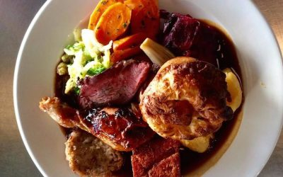 Overhead shot of a roast dinner with Yorkshire pudding and gravy