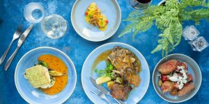 four dishes on the blue table