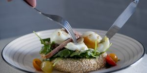Poached egg with spinach and cherry tomatoes