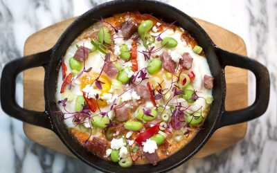 Shakshuka with egg, chilli and edamame beans served in a skillet