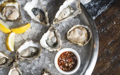 Oyster platter on ice with lemon and mignonette sauce