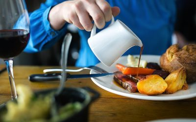 Sunday roast served with gravy being poured over the dish