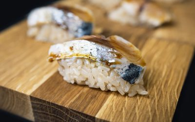 Fish and rice presented on a wooden board