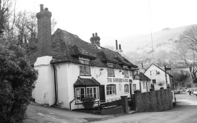 Black and white photo of the exterior of The Shepherd & Dog pub