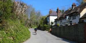 Cyclists riding along a country lane passed the pub on a bright Summers day