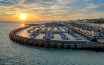 A sunset view of Brighton Marina with the sea, sky and Brighton in the background.