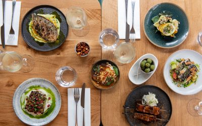 table for four laide out with small plates