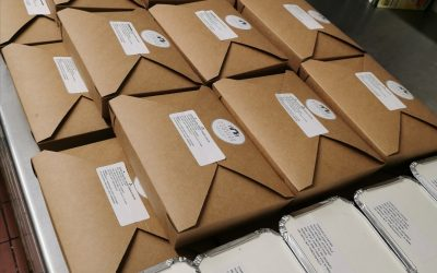 A picture of lots of traybake orders from Starfish and Coffee all packaged up and ready to be delivered