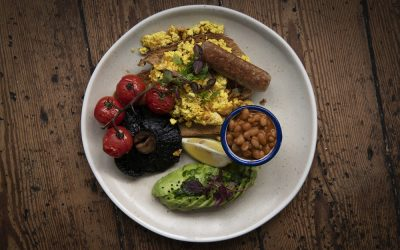 Breakfast with sausage, scambled egg, beans and grilled vine tomatoes
