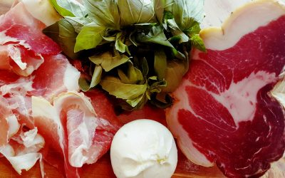 Sliced meat with fresh mozzarella and basil