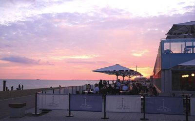 Alfresco dining with a beach sunset at West Beach Bar & Kitchen