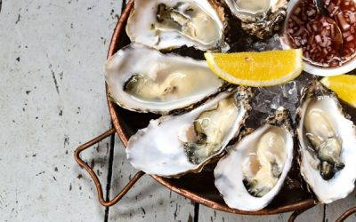 A platter of large oysters with fresh lemon and shallot vinegar