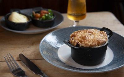 Individual meat free pie with vegetables and a glass of beer